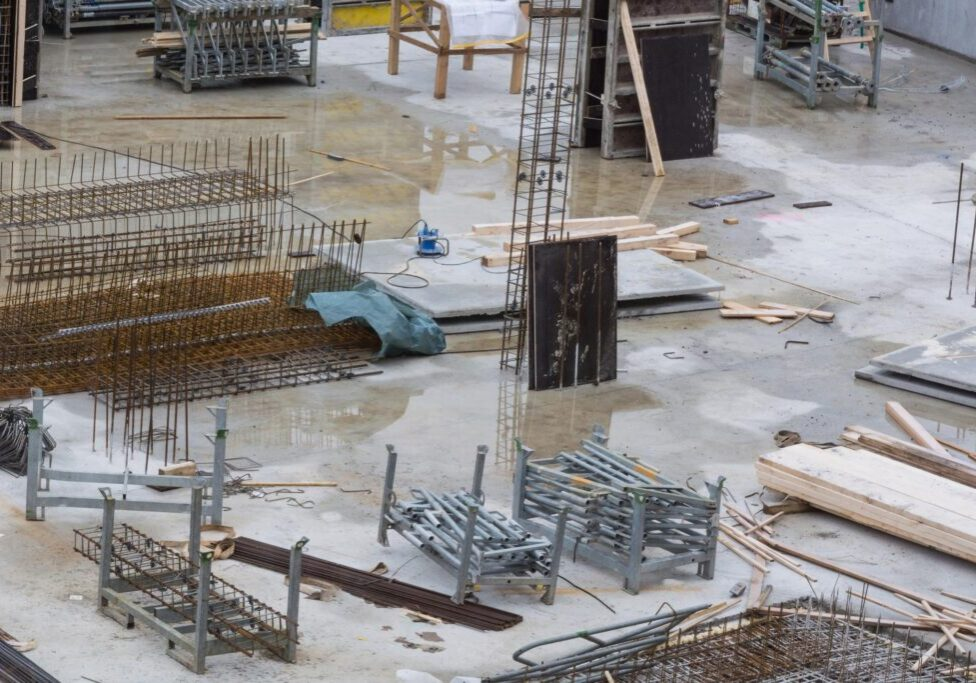under construction site with metals and cement